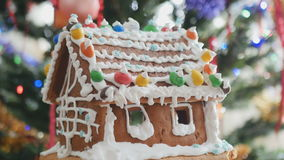 Gingerbread house with cream treble clef at the side stock video