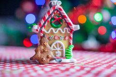 Gingerbread house decorated by sweet candies on a Stock Image
