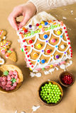 Gingerbread House. Decorated with white royal icing and bright candies royalty free stock photo