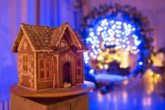 Gingerbread house. European Christmas holiday traditions. Garland blue lights on background. Xmas holiday sweets Royalty Free Stock Photos