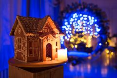 Gingerbread house. European Christmas holiday traditions. Garland blue lights on background. Xmas holiday sweets Royalty Free Stock Photography