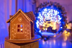 Gingerbread house. European Christmas holiday traditions. Garland blue lights on background. Xmas holiday sweets Royalty Free Stock Photo