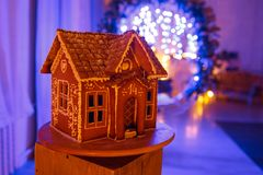 Gingerbread house. European Christmas holiday traditions. Garland blue lights on background. Xmas holiday sweets Stock Photo