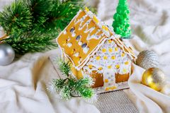 Gingerbread house on festive Christmas snow background. Royalty Free Stock Image