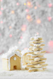 Gingerbread house and fir-tree on the background of bokeh and snow Stock Photography