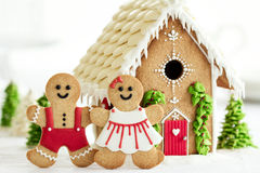 Gingerbread house with gingerbread couple stock images
