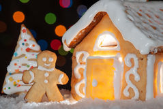 Gingerbread house with gingerbread man Stock Images