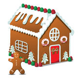 Gingerbread house and gingerbread man Stock Photography