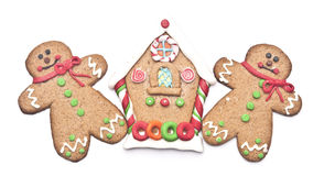 Gingerbread house with gingerbread man Stock Photos