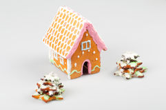 Gingerbread house and gingerbread pine trees Stock Images