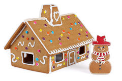 Gingerbread House with Gingerbread Snowman Royalty Free Stock Photo