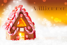 Gingerbread House, Golden Background, Willkommen Means Welcome Royalty Free Stock Photography