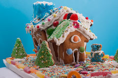 Gingerbread House isolated on blue Royalty Free Stock Photos