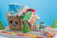 Gingerbread House isolated on blue Royalty Free Stock Photography