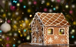 Gingerbread house with lights on christmas background Royalty Free Stock Photography
