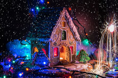 Gingerbread house with lights. On dark background, xmas theme stock images