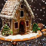 Gingerbread house with lights. On dark background, xmas theme royalty free stock photo