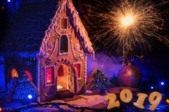 Gingerbread house with lights. On dark background, xmas theme stock photo