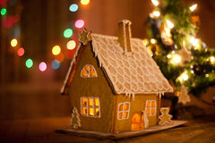 Gingerbread house with lights inside Royalty Free Stock Images