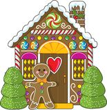 Gingerbread House and Man. A cute little decorated gingerbread house with a gingerbread man standing at the doorway. Candies and gumdrops are part of the royalty free illustration