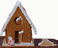 Gingerbread house. A gingerbread  house with a man and a detail on the board Stock Photo