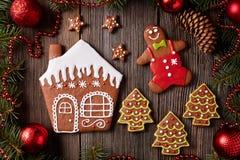 Gingerbread house, man, stars and fir trees Stock Photos