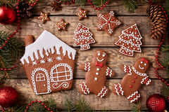 Gingerbread house, man and woman, fir trees, stars Stock Photography