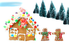 Gingerbread house with men and trees Stock Images