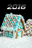 Gingerbread house and number 2016 Royalty Free Stock Photos