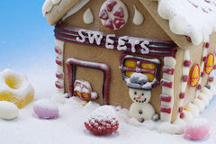 Gingerbread house and other sweets. On blue background Stock Images
