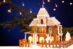 Gingerbread house over christmas background Royalty Free Stock Image