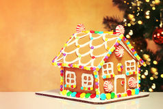 Gingerbread House over Christmas Tree Royalty Free Stock Photos