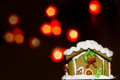 Gingerbread house and over defocused lights. Christmas background royalty free stock photos
