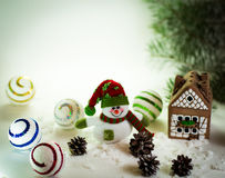 Gingerbread house over and lovely handmade snowman Royalty Free Stock Photo