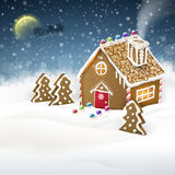 Gingerbread house over snow field Royalty Free Stock Photos