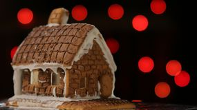 Gingerbread House Red Lights. Gingerbread house with red lights bokeh circles blur Christmas garland Happy New Year stock photos