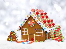 Gingerbread house with silver background royalty free stock photos