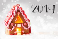 Gingerbread House, Silver Bokeh Background, Text 2019, Snow Stock Image