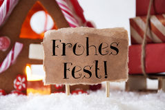 Gingerbread House With Sled, Frohes Fest Means Merry Christmas Stock Photo