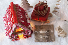 Gingerbread House, Sled, Snow, Weihnachtsferien Means Christmas Break Royalty Free Stock Images