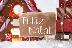 Gingerbread House With Sled, Snowflakes, Feliz Natal Means Merry Christmas Royalty Free Stock Photography