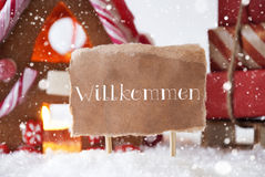 Gingerbread House With Sled, Snowflakes, Willkommen Means Welcom Royalty Free Stock Images