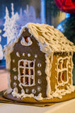 Gingerbread house. Gingerbread snow-covered house with gleam Royalty Free Stock Photo