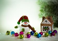 Gingerbread house and snowman Royalty Free Stock Image