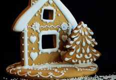 Gingerbread house and tree form homemade cookies for children fun Royalty Free Stock Image