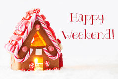 Gingerbread House, White Background, Text Happy Weekend. Gingerbread House In Snowy Scenery As Christmas Decoration With White Background. Candlelight For Royalty Free Stock Image