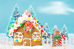 Gingerbread House With Man And Trees Stock Photos
