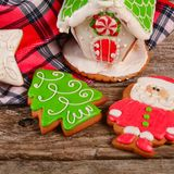 Gingerbread house on wooden background royalty free stock images