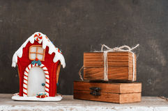 Gingerbread house and wooden gift boxes Stock Image