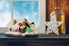 Gingerbread house on wooden table. Christmas decoration. Shallow Stock Images